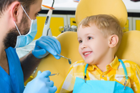 Pediatric Dentist with a child patient.